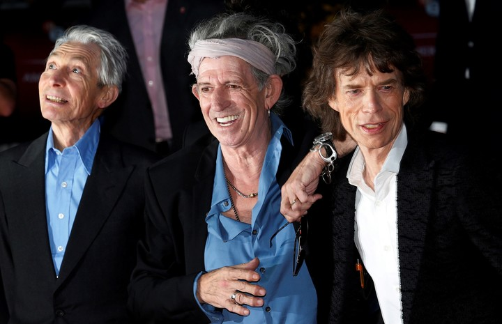 Charlie Watts with Keith Richards and Mick Jagger, the people responsible for his becoming a full-fledged rock musician.  Photo REUTERS / Suzanne Plunkett