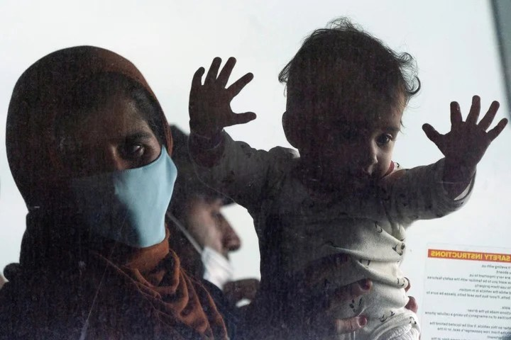 One of the families evacuated from Afghanistan.  AP Photo