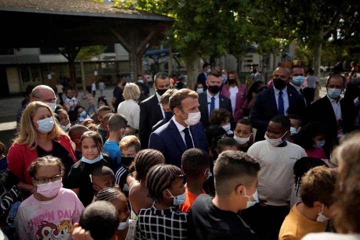 Surrounded by people, President Emmanuel Macron in Marseille.  Reuters photo