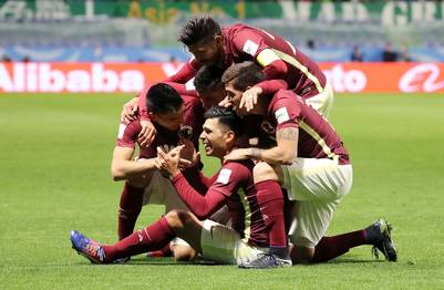 Club America's Silvio Romero, bottom, celebrates his goal against Jeonbuk Motors with his teammates during their match at the FIFA Club World Cup soccer tournament at Suita City Football Stadium in Suita, west Japan, Sunday, Dec. 11, 2016. (AP Photo/Eugene Hoshiko)