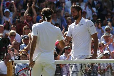 Switzerland's Roger Federer (L) shakes hands with Croatia's Marin Cilic (R) after Federer won their men's singles quarter-final match on the tenth day of the 2016 Wimbledon Championships at The All England Lawn Tennis Club in Wimbledon, southwest London, on July 6, 2016. / AFP PHOTO / JUSTIN TALLIS / RESTRICTED TO EDITORIAL USE