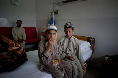 Pakistani children Abdul Rasheed, 9, left, and Shoaib Ahmed, 13, sit in a room during a day at a hospital in Islamabad, Pakistan Friday May 6, 2016. The boys are normal active children during the day. But once the sun goes down, they both lapse into a vegetative state — unable to move or talk. Dr. Javed Akram, told The Associated Press on Thursday that he had no idea what was causing the symptoms. (AP Photo/B.K. Bangash)