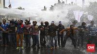 Massa Pendukung Referendum Papua Ditembak Water Canon