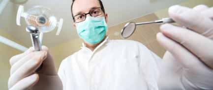 Image result for dentist with tools
