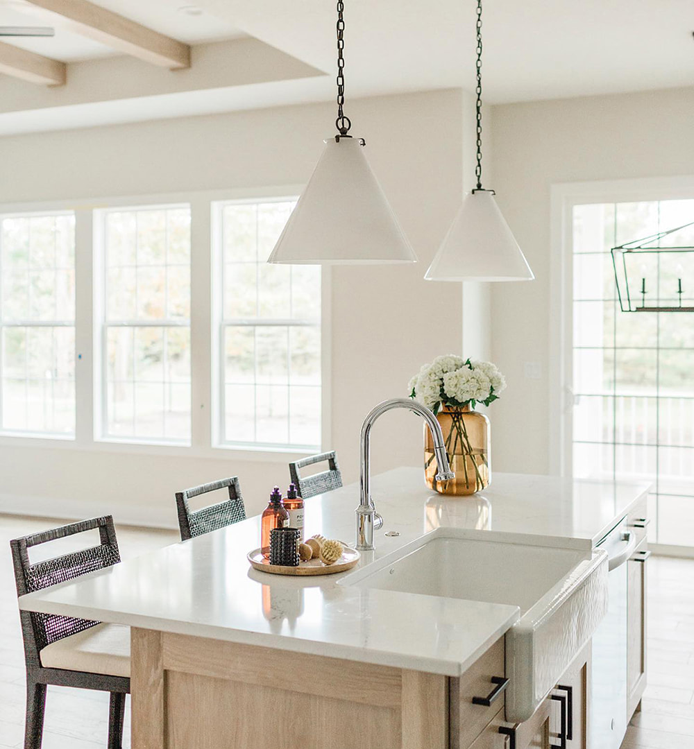 Double Hung Windows And Patio Door Welcome Natural Light To Traditional Kitchen Pella