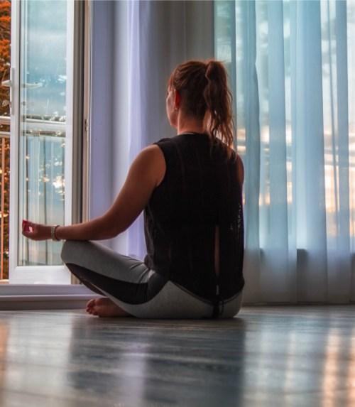 woman-meditate-near-window