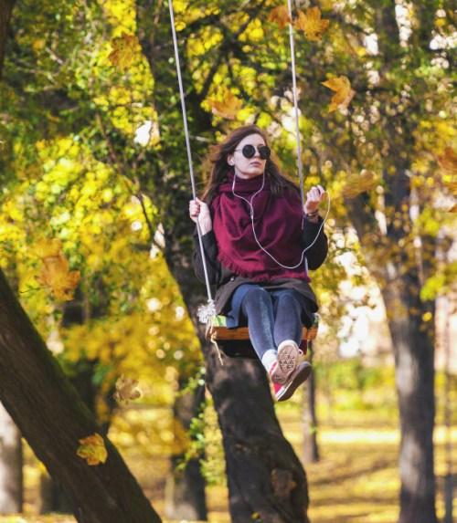 woman-swings-in-a-tree