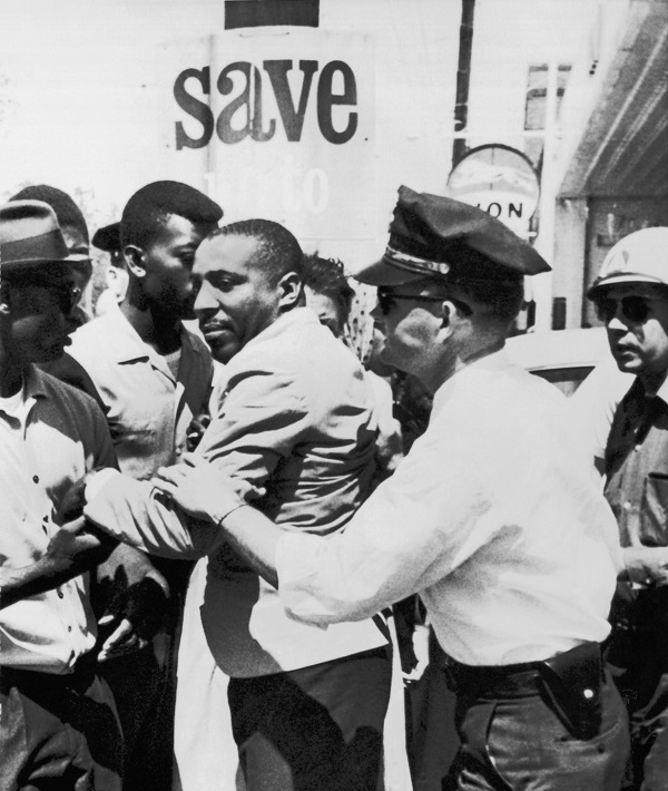 civil rights movement - Mandatory Credit: Photo by Underwood Archives/REX/Shutterstock (4436543a) Greenwood, Mississippi: April 2, 1963 A policeman applies an arm lock on comedian Dick Gregory after he left the Leflore County Court House to help Negroes register to vote. VAR