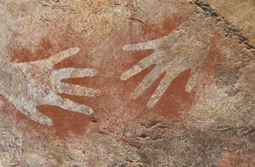 cave painting/drawing shows 2 hands