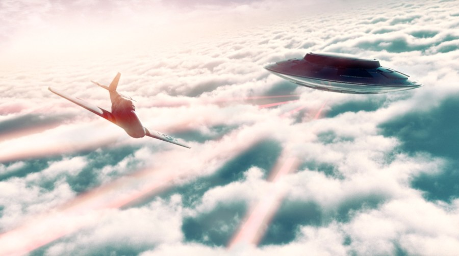 Aircraft and UFO flying over the clouds
