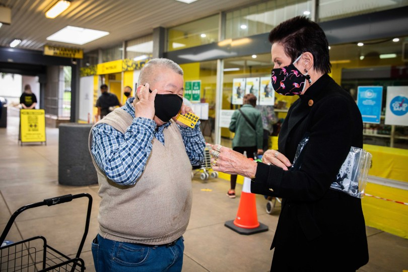 Lord Mayor Clover Moore distributing free face masks.
