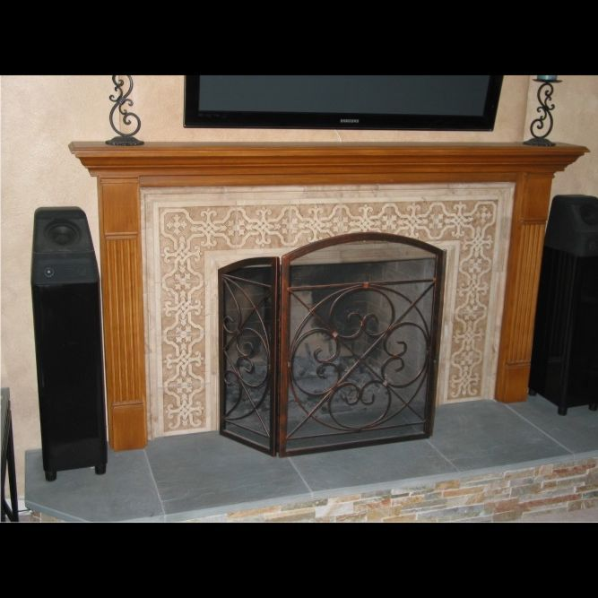 carved marble tile fireplace surround