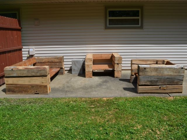 handmade outdoor chairs and sofa made from reclaimed barn wood
