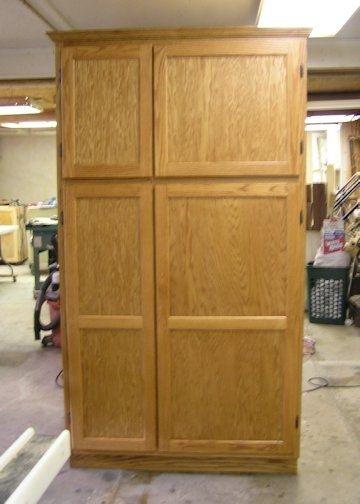 Handmade 7 Foot Tall Oak Pantry With Hidden Gun Storage By