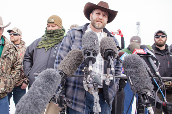 Ammon Bundy(C), leader of a group of armed anti-government protesters speaks to the media as other members look on at the Malheur National Wildlife Refuge near Burns, Oregon January 4, 2016. The FBI on January 4 sought a peaceful end to the occupation by