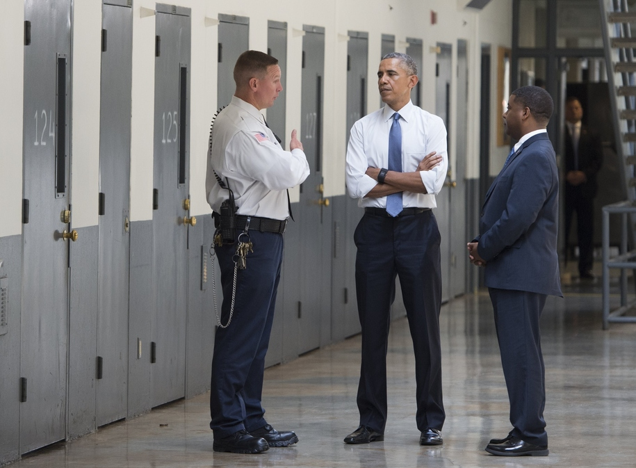 US President Barack Obama, alongside Charles Samuels (R), Bureau of Prisons Director, and Ronald Warlick (L), a correctional officer, tours a cell block at the El Reno Federal Correctional Institution in El Reno, Oklahoma, July 16, 2015. Obama is the firs