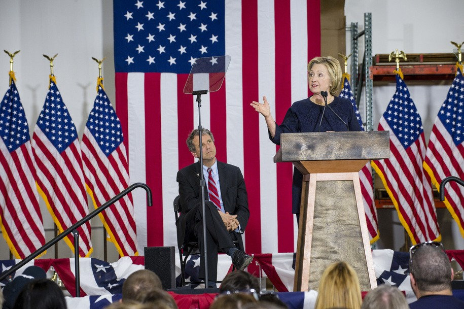 CLEVELAND, OH - JUNE 13: Democratic presidential candidate Hillary Clinton speaks to supporters at the Cleveland Industrial Innovation Center on June 13, 2016 in Cleveland, Ohio. In the wake of the shooting in Orlando, Florida, Clinton is campaigning in Ohio and Pennsylvania to present her vision for a stronger and safer America. Also pictured is Sen. Sherrod Brown (D-OH). (Photo by Angelo Merendino/Getty Images)