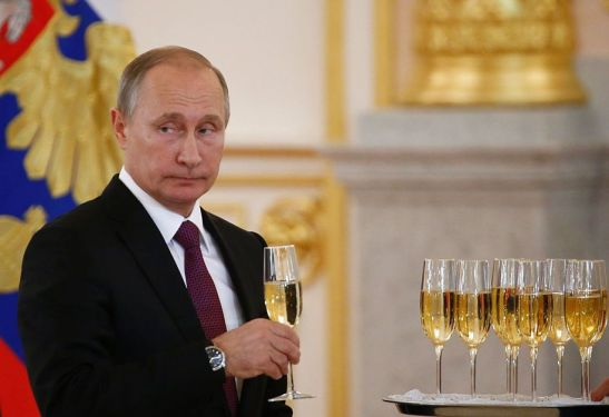 Russia's President Vladimir Putin holds a glass during a ceremony of receiving diplomatic credentials from foreign ambassadors at the Kremlin in Moscow on November 9, 2016. / AFP / POOL / SERGEI KARPUKHIN (Photo credit should read SERGEI KARPUKHIN/AFP/Getty Images)