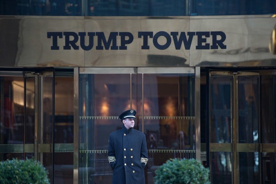 A doorman stands in front of Trump Tower during the Women's March in New York City on January 21, 2017 in New York. .Hundreds of thousands of people flooded US cities Saturday in a day of women's rights protests to mark President Donald Trump's first full day in office. / AFP / Bryan R. Smith (Photo credit should read BRYAN R. SMITH/AFP/Getty Images)