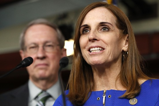 """FILE - In this Jan. 10, 2018 file photo, House Homeland Security Border and Maritime Security Subcommittee Chairwoman Rep. Martha McSally, R-Ariz., right, speaks during a news conference with House Judiciary Committee Chairman Rep. Bob Goodlatte, R-Va. on Capitol Hill in Washington.  McSally called on the national GOP to """"grow a pair of ovaries"""" as she launched her bid for the U.S. Senate on Friday, Jan. 12, joining the race to replace retiring GOP Sen. Jeff Flake by embracing President Donald Trump and his outsider playbook in one of the nation's premier Senate contests. (AP Photo/Jacquelyn Martin, File)"""