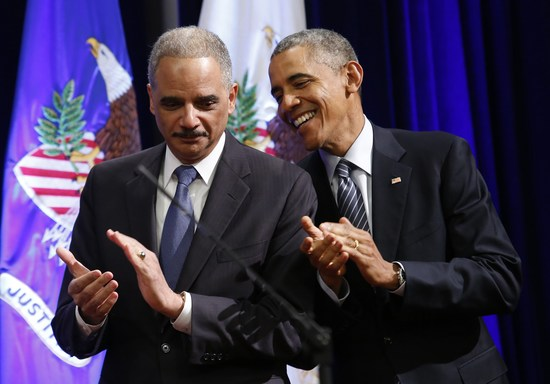 US President Barack Obama (R) talks to outgoing Attorney General Eric Holder at the portrait unveiling ceremony at the Justice Department in Washington, DC on February 27, 2015. The event marks Holder's anticipated departure after more than six years of service. AFP PHOTO/ YURI GRIPAS        (Photo credit should read YURI GRIPAS/AFP/Getty Images)