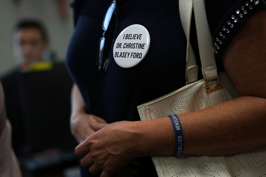 WASHINGTON, DC - SEPTEMBER 20:  An activists wears a button in support of Christine Blasey Ford, who has accused Supreme Court nominee Judge Brett Kavanaugh of sexual assault at a high school party about 35 years ago, during a protest September 20, 2018 on Capitol Hill in Washington, DC. Activists protested against Supreme Court nominee Judge Brett Kavanaugh.  (Photo by Alex Wong/Getty Images)