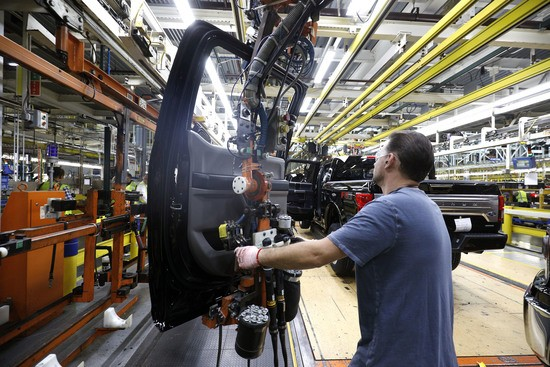 DEARBORN, MI - SEPTEMBER 27:  A Ford Motor Company workers works on a Ford F150 truck on the assembly line at the Ford Dearborn Truck Plant on September 27, 2018 in Dearborn, Michigan. The Ford Rouge Plant is celebrating 100 years as America's longest continuously operating auto plant. The factory produced Eagle Boats during WWI and currently produces the Ford F150 pickup truck. (Photo by Bill Pugliano/Getty Images)