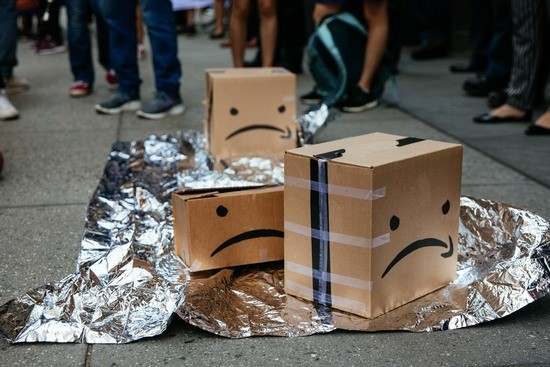 NEW YORK, NY - JULY 15: Protestors left Amazon boxes on the ground in front of an Amazon store on 34th St. on July 15, 2019 in New York City. The protest, raising awareness of Amazon facilitating ICE surveillance efforts, coincides with Amazon's Prime Day, when Amazon offers discounts to Prime members. (Photo by Kevin Hagen/Getty Images)