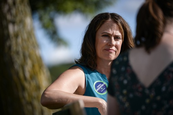 UNITED STATES - AUGUST 11: Democratic senate candidate Theresa Greenfield speaks with a reporter at a picnic hosted by the Adair County Democrats in Greenfield, Iowa on Sunday August 11, 2019. (Photo by Caroline Brehman/CQ Roll Call via AP Images)