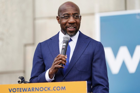 Democratic U.S. Senate candidate Raphael Warnock speaks to labor organizers and the media outside a labor union's offices in Atlanta, Georgia, U.S. January 5, 2021.  REUTERS/Elijah Nouvelage