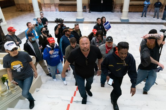 "ATLANTA, GA - NOVEMBER 18: Alex Jones, host of Infowars, an extreme right-wing program that often trafficks in conspiracy theories, is seen inside the Georgia State Capitol during a ""Stop the Steal"" rally against the results of the U.S. Presidential election on November 18, 2020 in Atlanta, Georgia. (Photo by Elijah Nouvelage/Getty Images)"