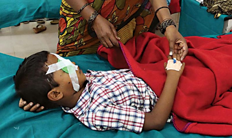 A boy who got injured while bursting crackers, undergoing treatment at Minto eye hospital in Bengaluru on Thursday --KPN