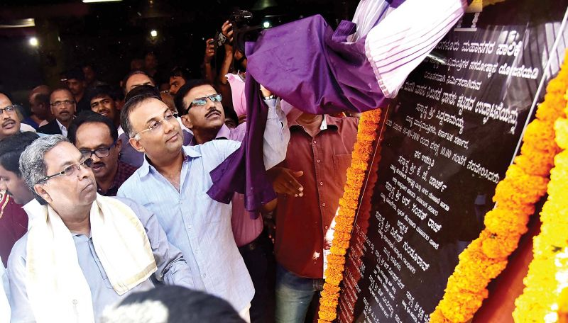 Chief Minister Siddaramaiah with MLA Dinesh Gundurao at the inauguration of BBMP Parking Complex at Freedom Park. (Photo:DC)