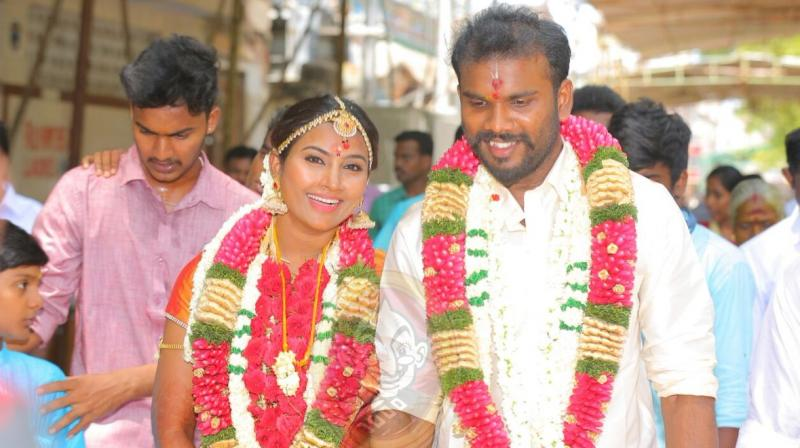 Nandhini and Karthikeyan on the day of their marriage.