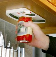 Jar Opener attached underneath a kitchen cupboard