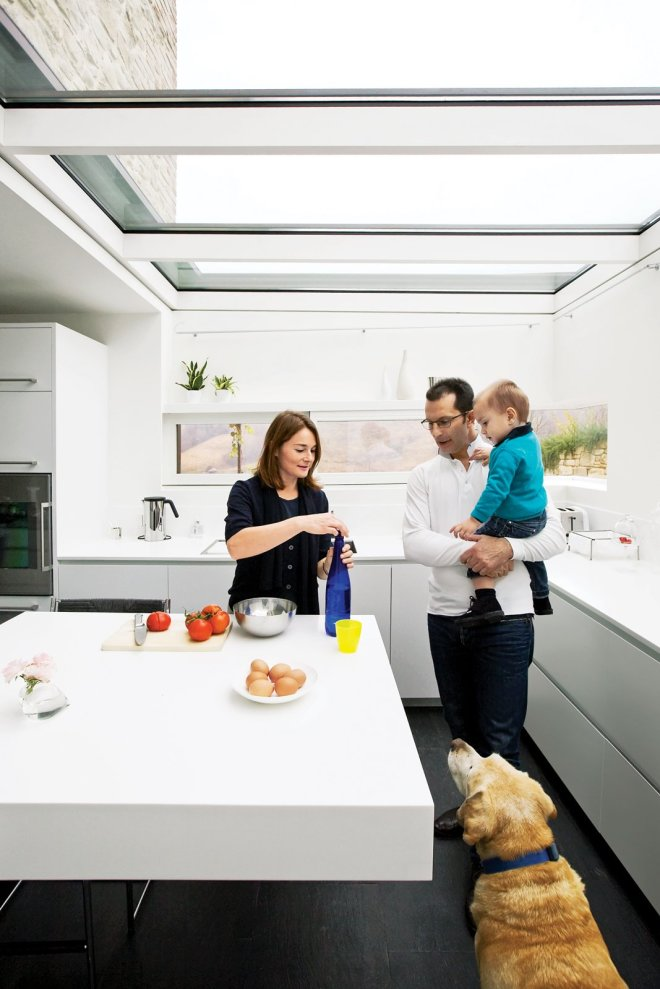 "These 30 White Kitchens Are Anything But Ordinary - Photo 19 of 30 - The architect placed the windows at Sabrina's eye level so that she'd be able to see her son, Rocco, playing in the yard outside. ""You can feel the seasons changing here,"" says Chiavelli. ""I grew up three miles from here, outside in nature. This is a house for experiencing life."""