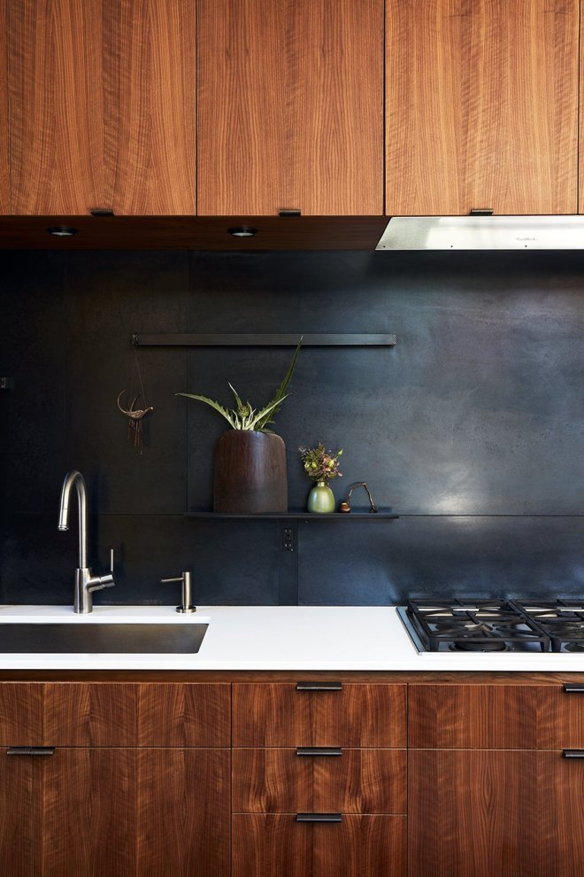 25 Backsplash Ideas For Your Kitchen Renovation - Photo 11 of 25 - The metal backsplash and drawer pulls were fabricated by 12th Avenue Iron; the cooktop is by Miele.