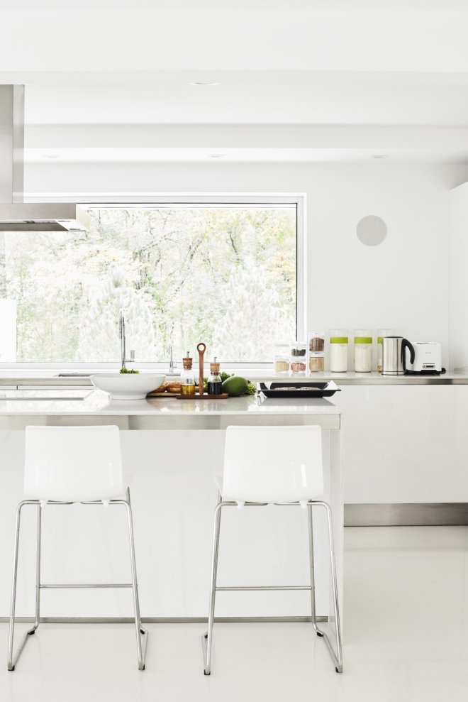 These 30 White Kitchens Are Anything But Ordinary - Photo 22 of 30 - For convenience, Eva and restoration architect Victor Drapszo moved the kitchen from the second floor to the first, which originally housed a garage, laundry area, and guest room. The cabinetry is Gamma by Arclinea, the countertops are Lagoon quartz by Silestone, and the floor is polished concrete.