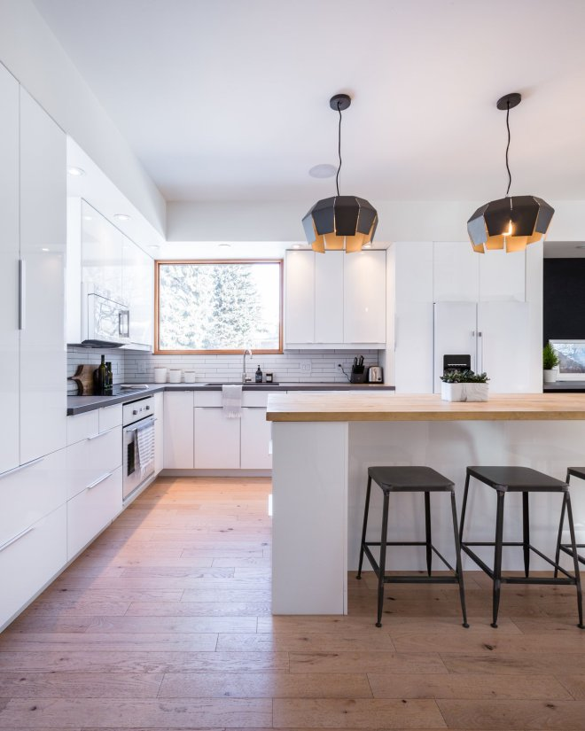 These 30 White Kitchens Are Anything But Ordinary - Photo 13 of 30 - The open plan of the white kitchen helps keep the interiors bright, while also creating a greater sense of spaciousness.