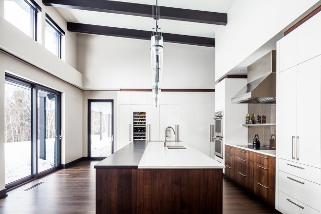 These 30 White Kitchens Are Anything But Ordinary - Photo 15 of 30 - The open concept design in this cabin features wooden details and a white kitchen.