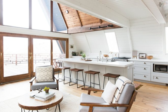 These 30 White Kitchens Are Anything But Ordinary - Photo 29 of 30 - The orientation of the kitchen was changed to allow sunlight from the slanting windows to better illuminate the cooking station.
