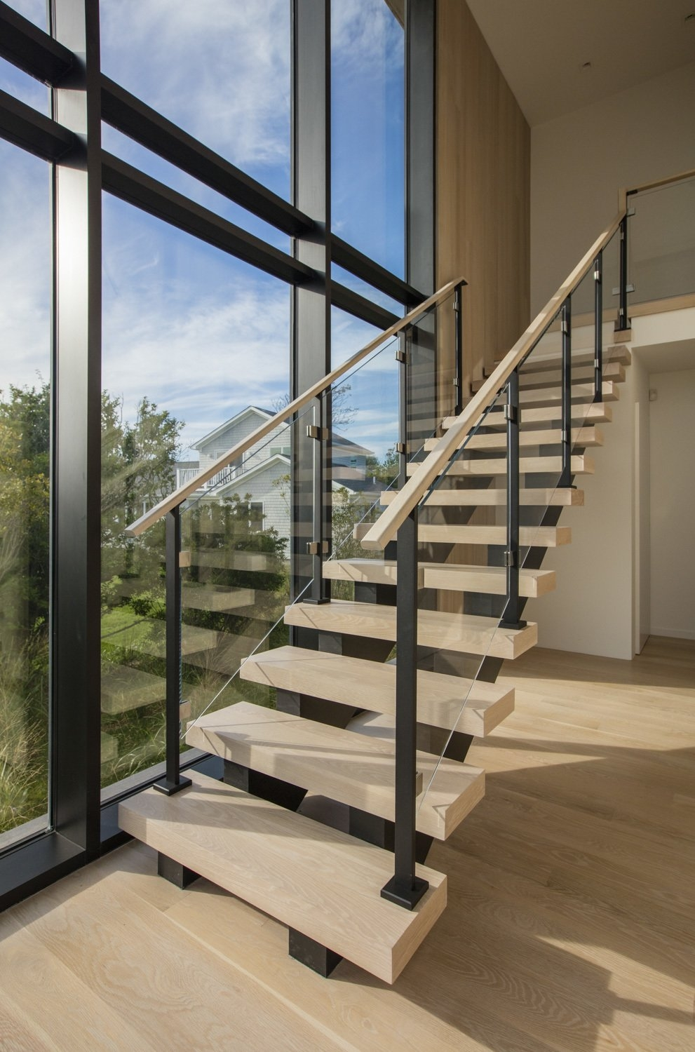 Photo 5 Of 6 In Montauk Party House Dwell   White Wood And Glass Staircase   Design   70'S   Thick Solid Oak Stair   Bannister   Indoor Glass