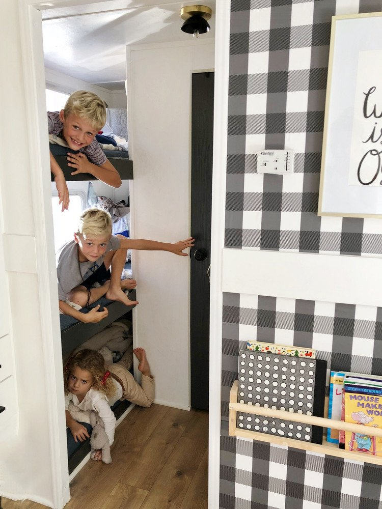 A Couple Spend $3K to Turn an Old RV Into a Cozy Home For Five - Photo 6 of 10 - Their three young children sleep in triple bunk beds in the opposite end of the RV.
