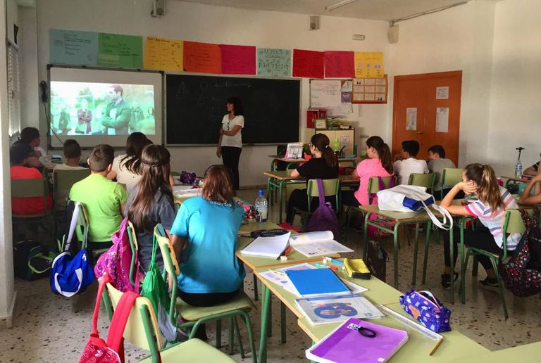 Students attend a talk on LGBTQ+ rights in Murcia.