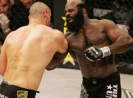 Kimbo Slice(left) uppercuts James Thompson (right)