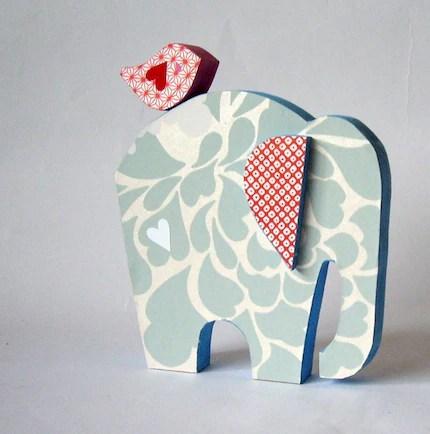 pale blue elephant with bird