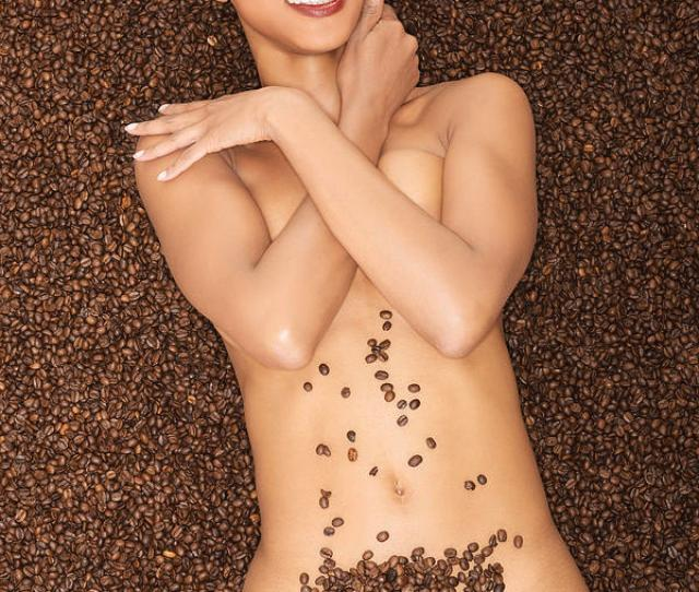 Attractive Naked Woman Lying In Coffee Grains
