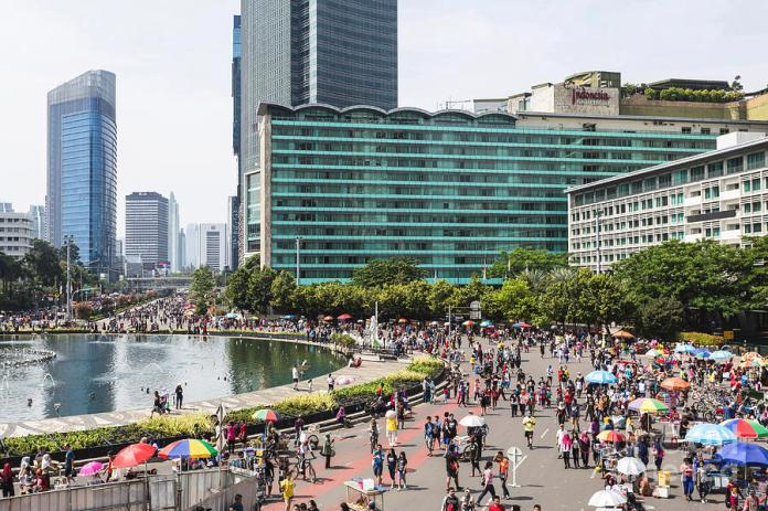 Crowd For The Car Free Day In Jakarta Indonesia Capital City Photograph By Didier Marti