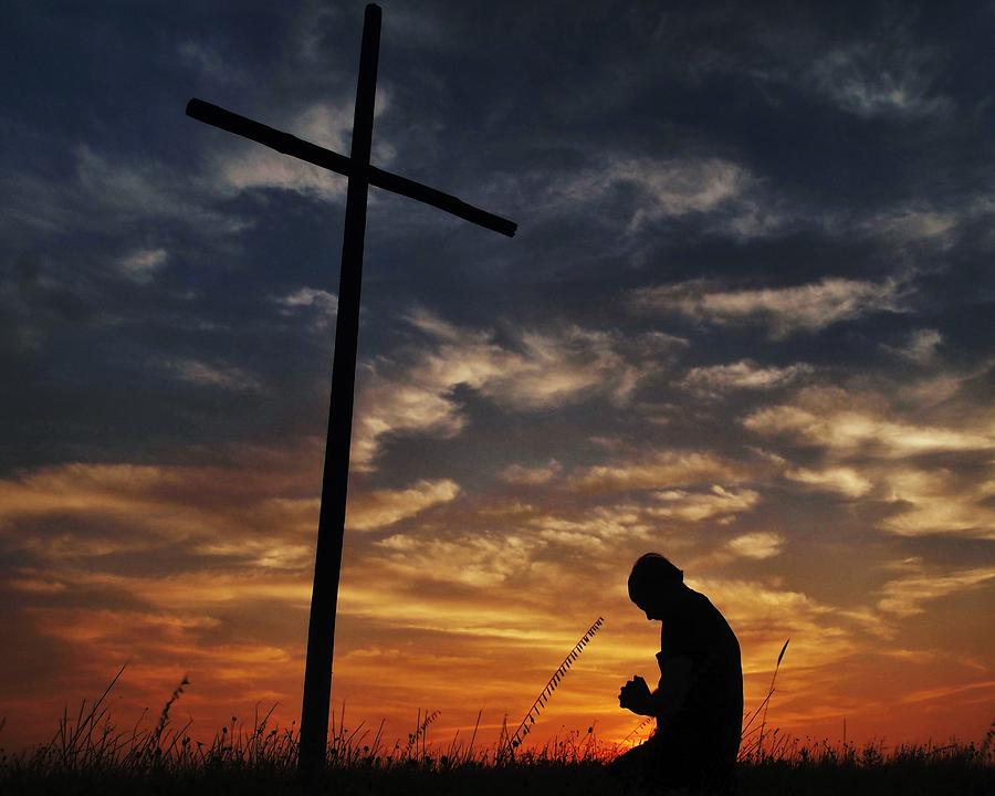Image result for praying at the cross