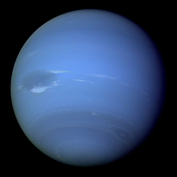In 1989, Voyager 2 passed 40,000 kilometres away from Neptune's largest moon, Triton, the last solid body the spacecraft will have an opportunity to study before entering interstellar space. Image credit: NASA/JPL